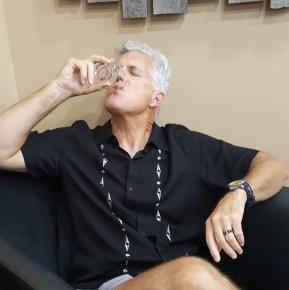 Greg sips Bourbon.jpg