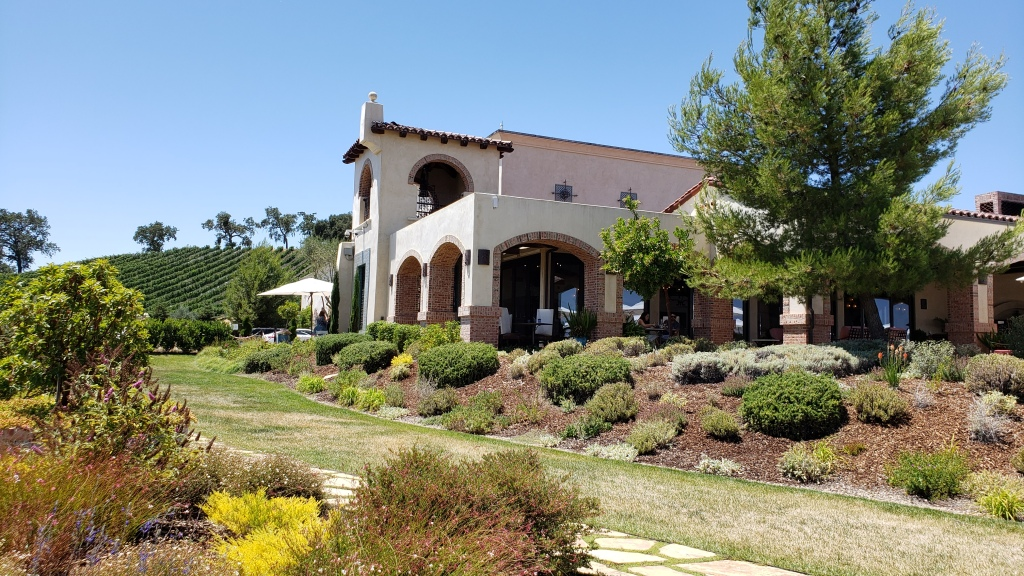 Winery building nestled among vineyards and gardens