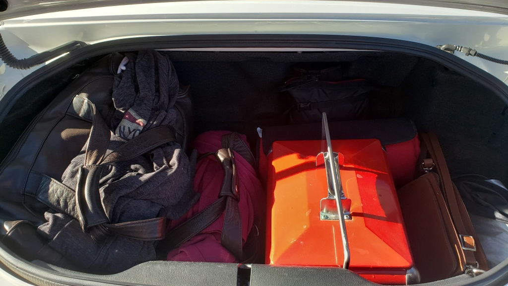 bags and small cooler in car trunk