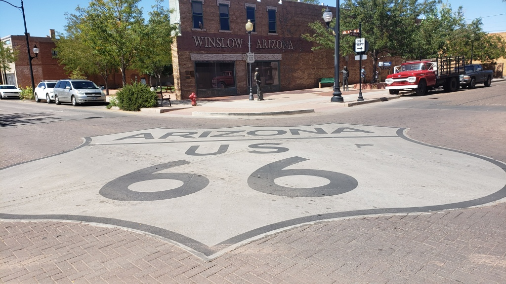 Route 66 shield on pavement in Winslow Arizona