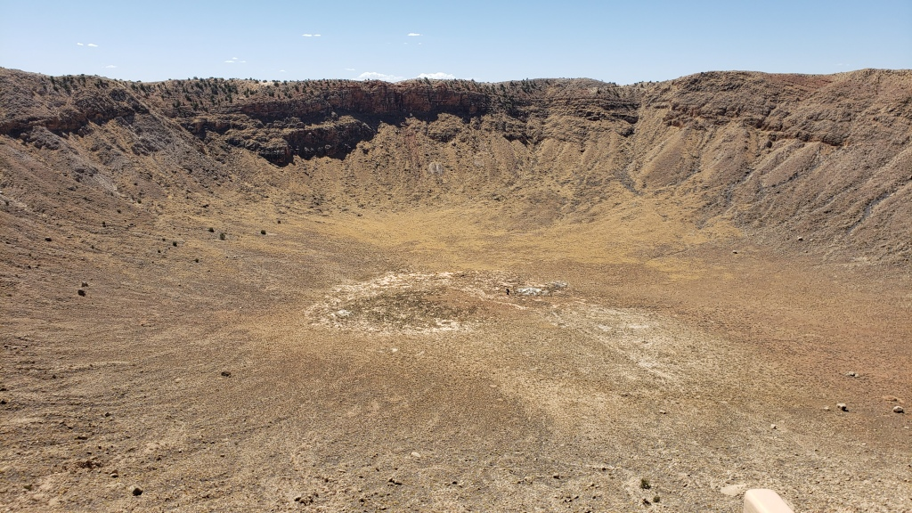 A huge meteor crater in the desert