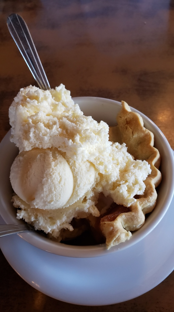 scoop of ice cream on piece of peach pie
