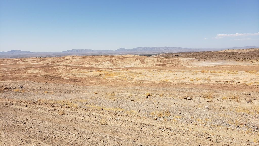 vast expanse of sand with mountains in distance