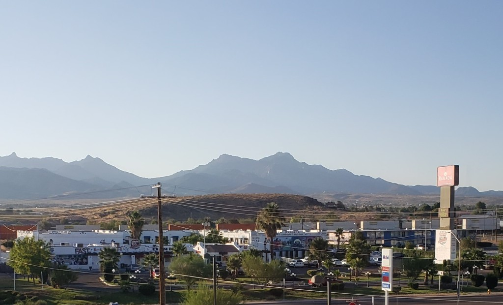 mountains in distance with buildings in foreground