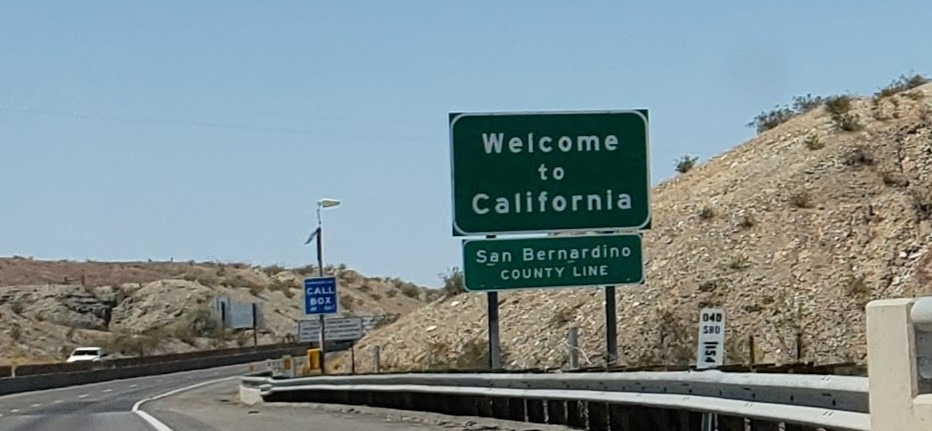 welcome to California sign on side of interstate.