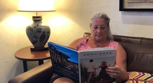 woman on couch reading book