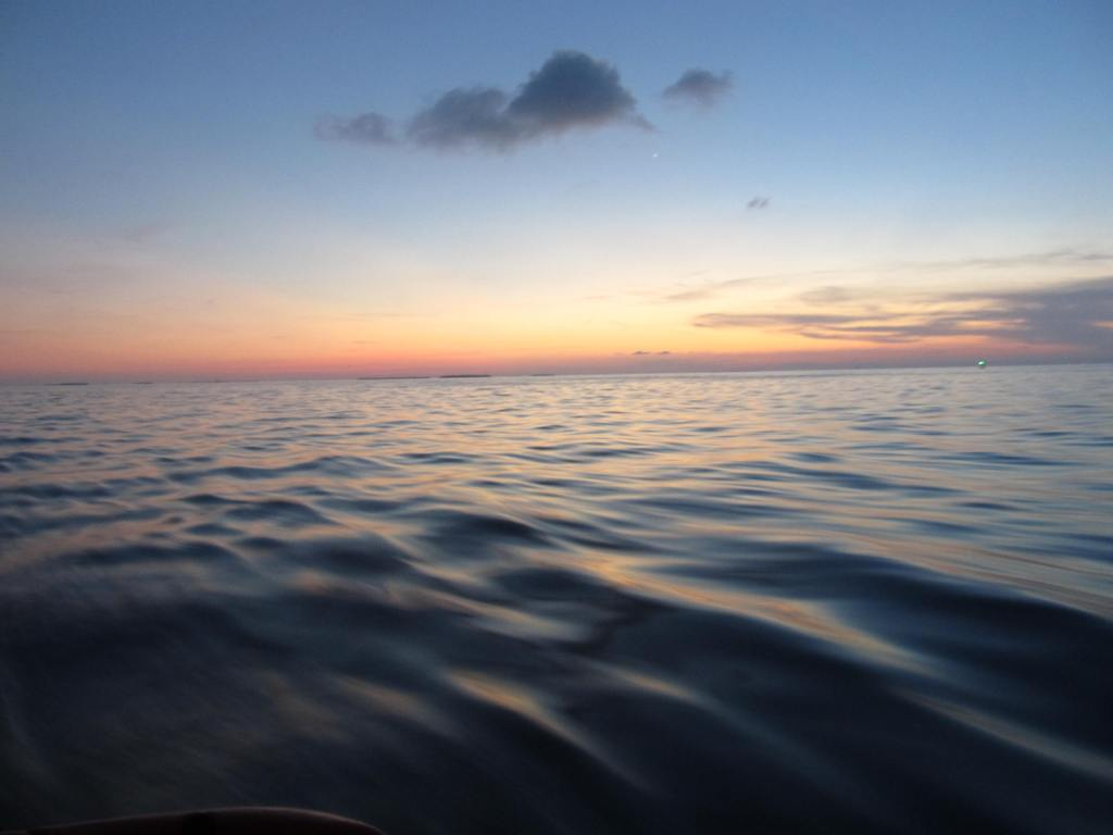 flat sea with colorful sunset on the horizon