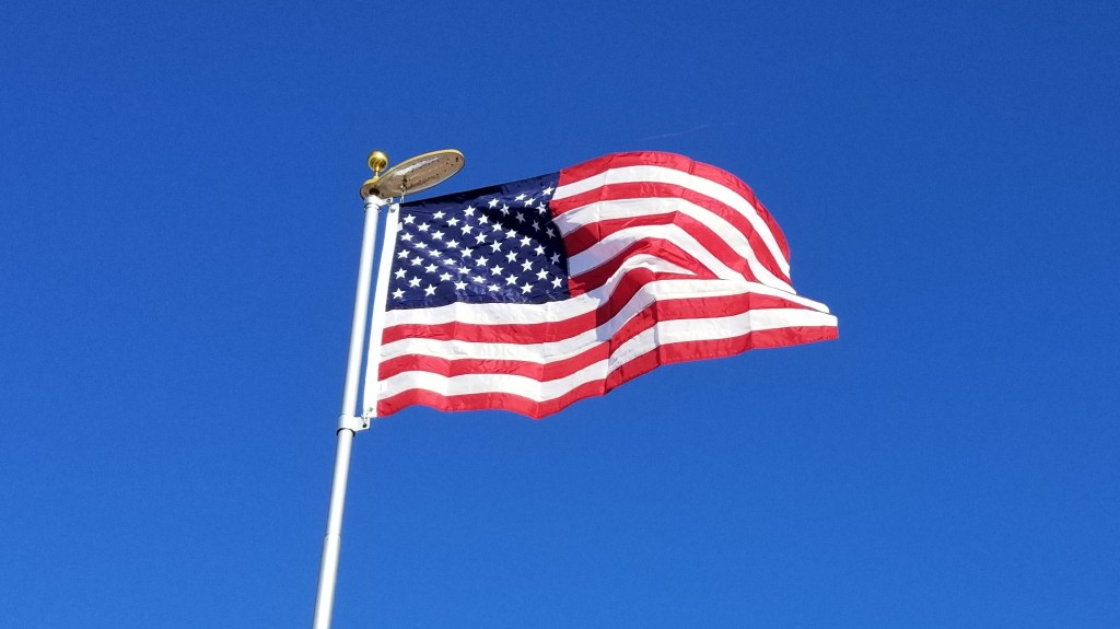 flag against blue sky
